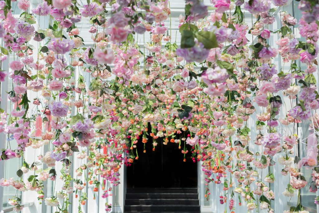 flowers hanging above reception space