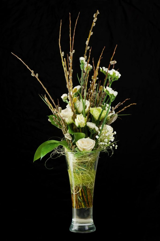 curly willow branches in floral arrangement