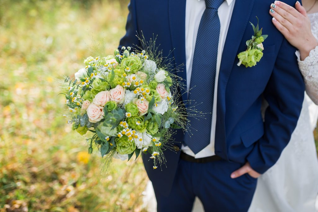 navy suit at wedding