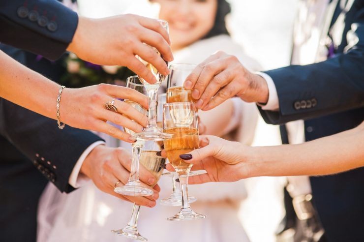 wedding guests toast at cocktail party