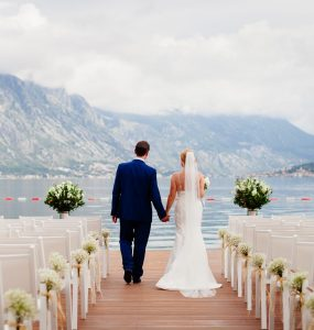 destination wedding couple looking at mountains