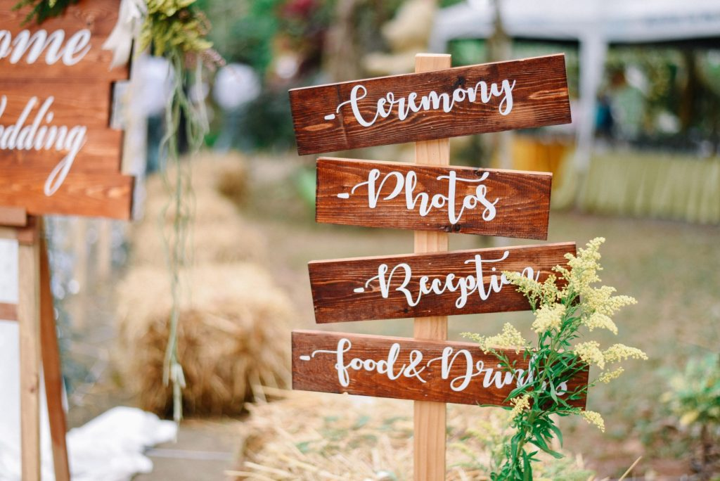 wooden sign at camp wedding