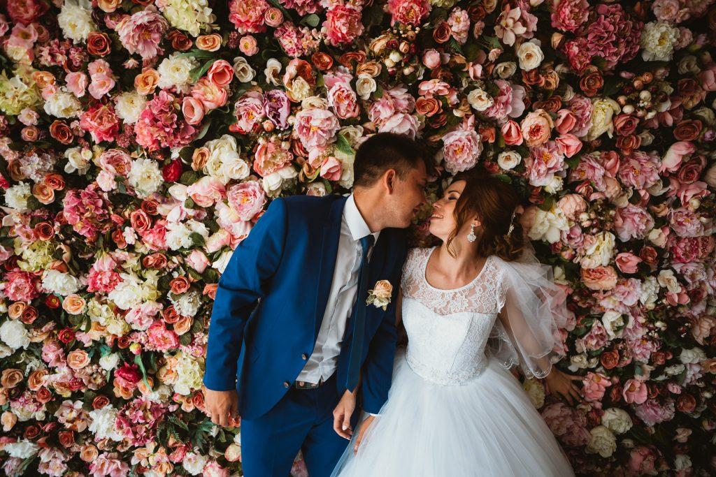 floral wall at wedding