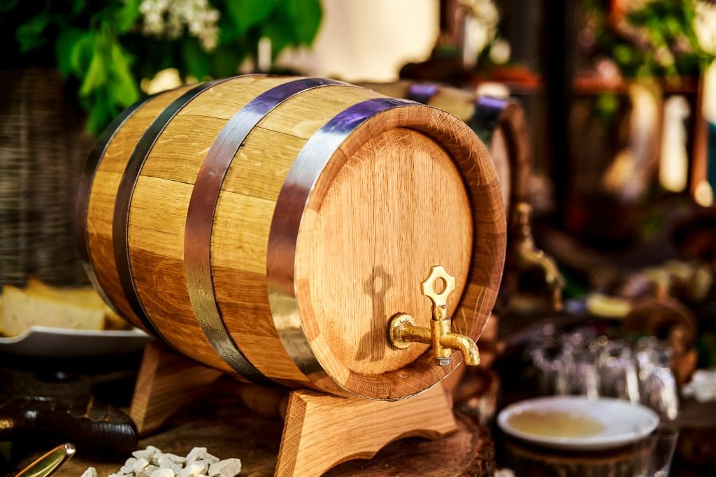 alcohol in a barrel on a wooden table