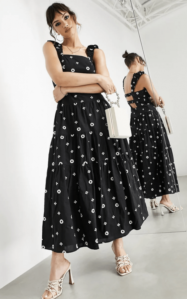 woman in black dress with daisies