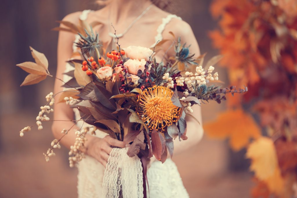 autumn bouquet in the hands of the bride