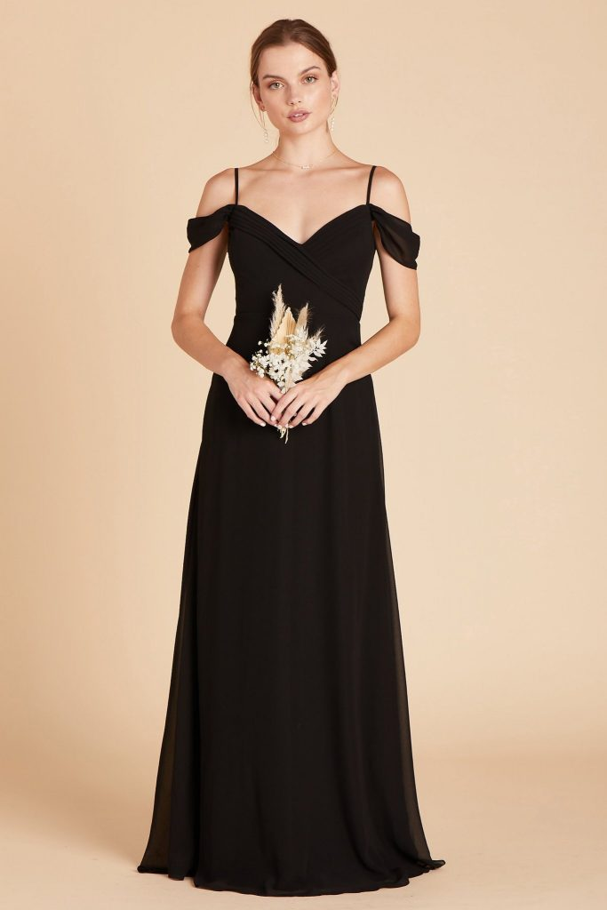 woman in long black cold shoulder dress