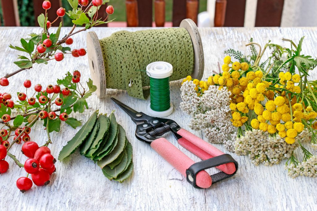 boutonniere materials on a table