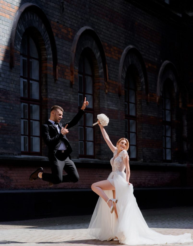 couple jumping in the air during their wedding photoshoot