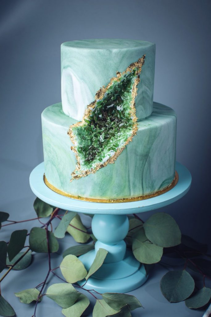 wedding cake decorated with green emeralds