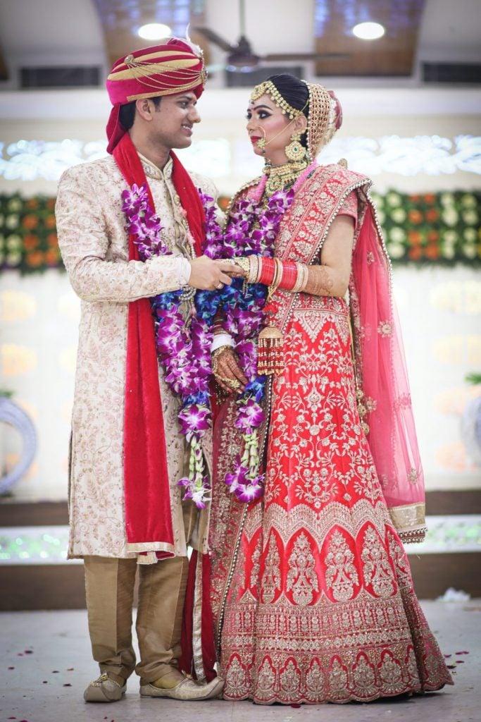 indian wedding couple wearing traditional Indian wedding attire