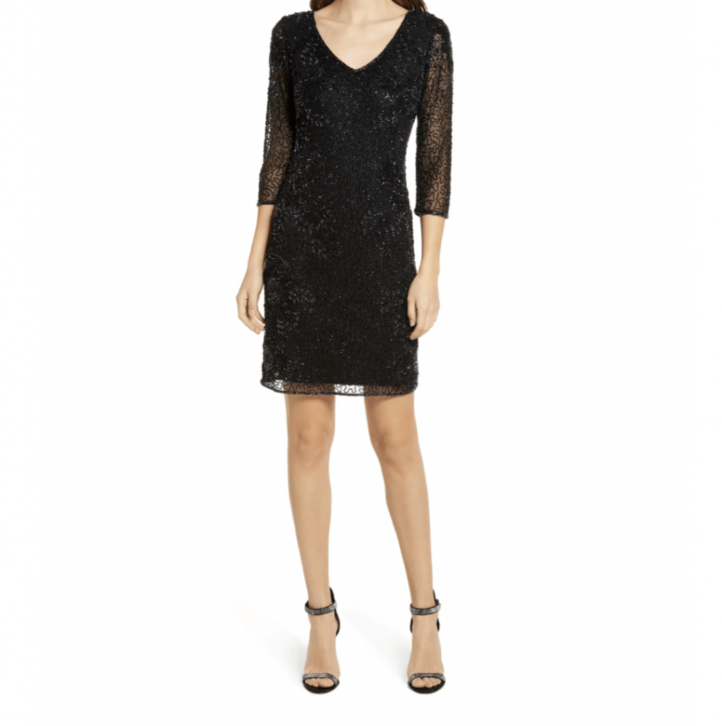 woman in black beaded cocktail dress