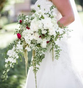 bride holding cascading wedding bouquet