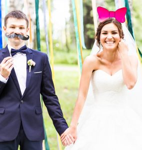 bride and groom using wedding photobooth
