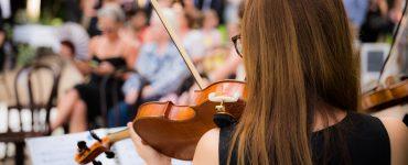 woman playing violin at wedding