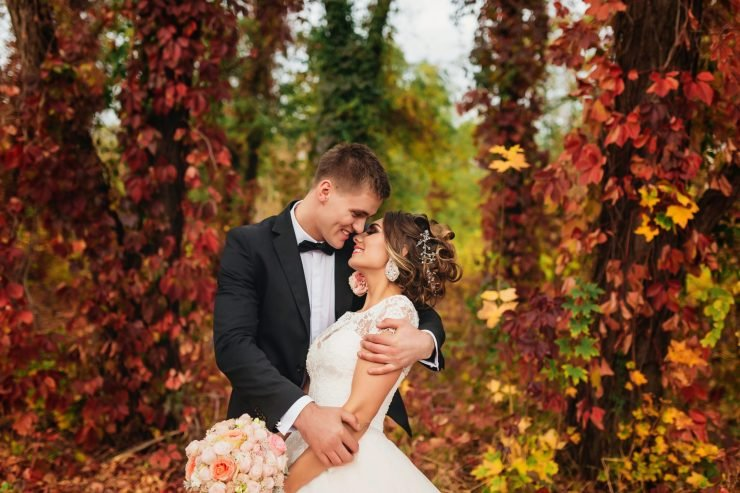 wedding couple surrounded by autumn nature