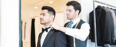 man trying on tuxedo