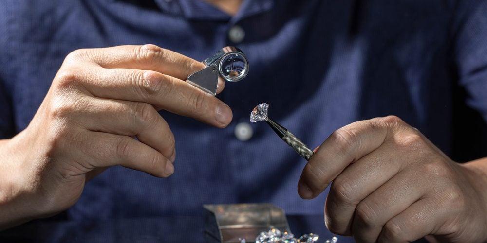 jeweler assessing diamond