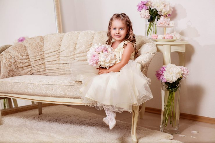flower girl sitting on couch