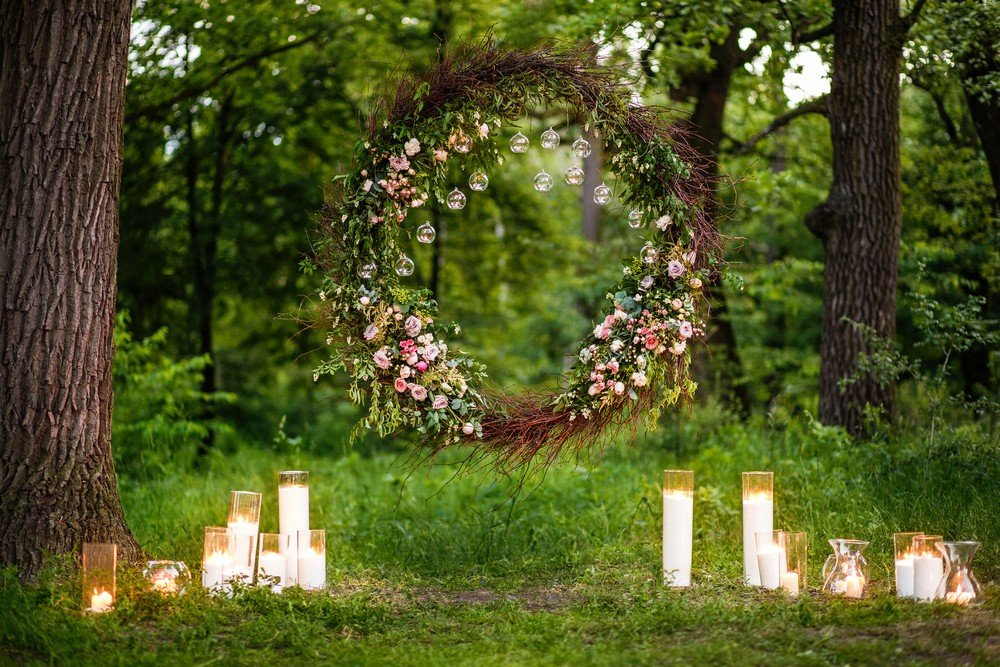 forest wedding arch and cancles