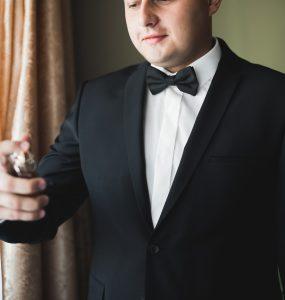 groom posing for photo