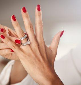 woman putting on wedding ring
