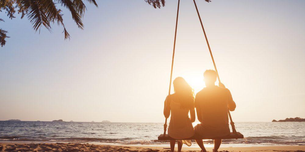 couple on beach honeymoon