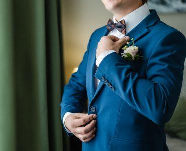 groom wearing blue tux