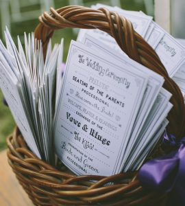 basket of wedding programs