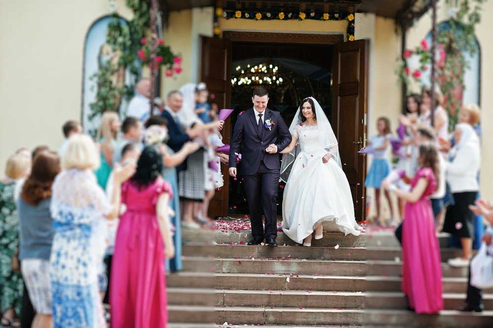 bride and groom exiting church